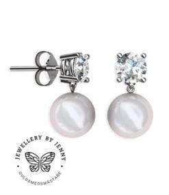 pärlörhängen med briljantslipade diamanter